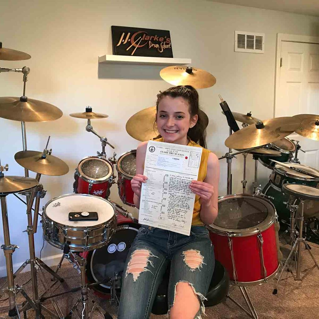 Drum student holding NYSSMA Certificate